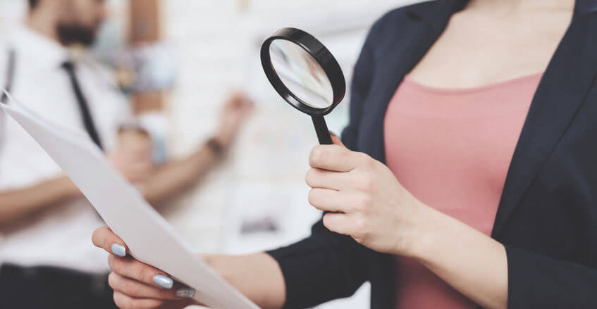 Woman Checking Paper